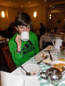 Drinking his morning tea.