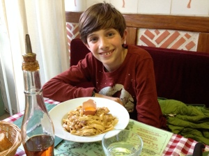 Ethan with his pasta carbonara, complete with raw egg in shell on top!